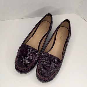 Arturo Chiang embossed patent leather shoes.